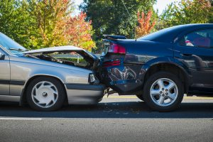 Two cars in a fender bender accident